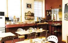 Hôtel des Oliviers : Salle petit-déjeuner